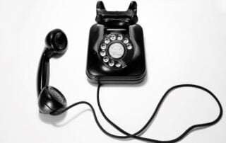 Picture of old phone to show need to upgrade to a new phone system Photo by Quino Al on Unsplash