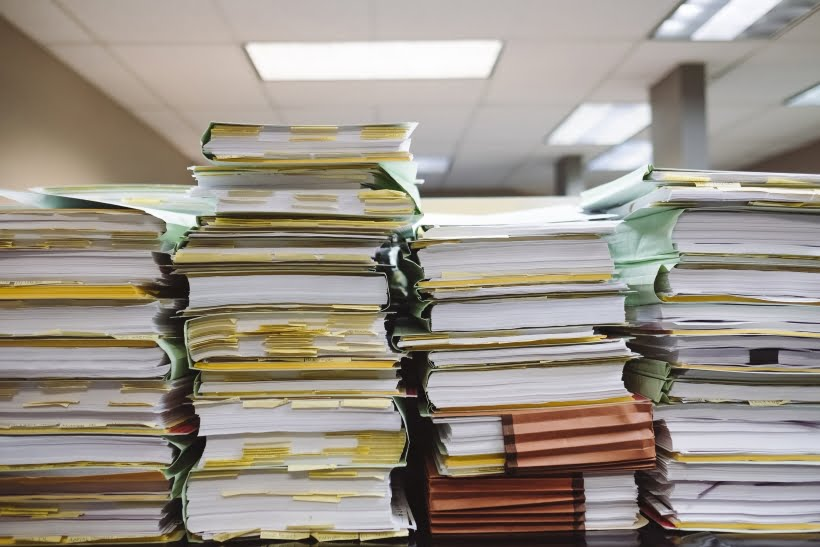 Paperwork to illustrate the move to artificial intelligence in invoice processing