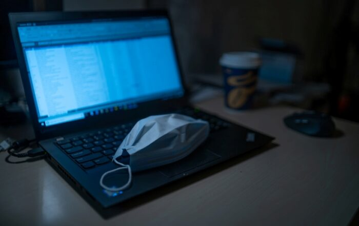 Face mask on laptop how to covid safe your business process