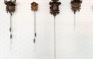 Several cuckoo clocks mounted on a wall