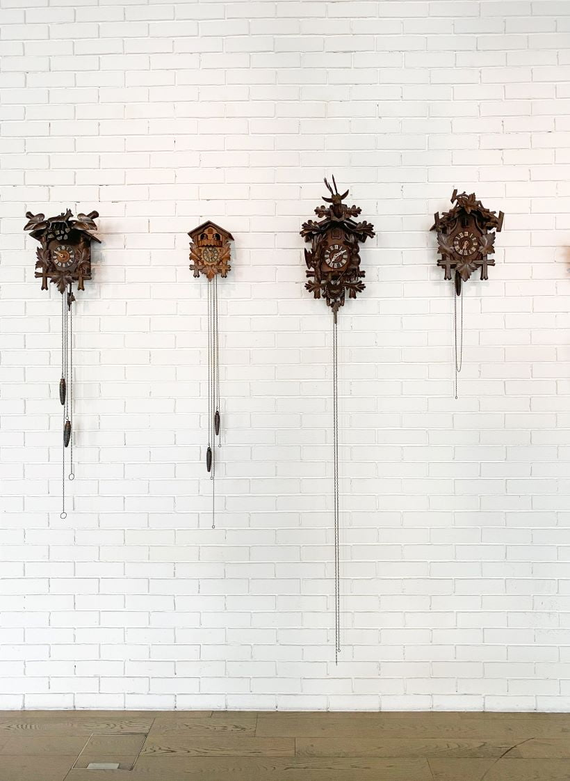 Several cuckoo clocks mounted on a wall
